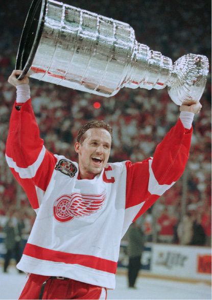 FILE - In this June 7, 1997, file photo, Detroit Red Wings captain Steve Yzerman skates off with the Stanley Cup after they swept the Philadelphia Flyers in four games, in Detroit. For the first time since 1990, the Red Wings won