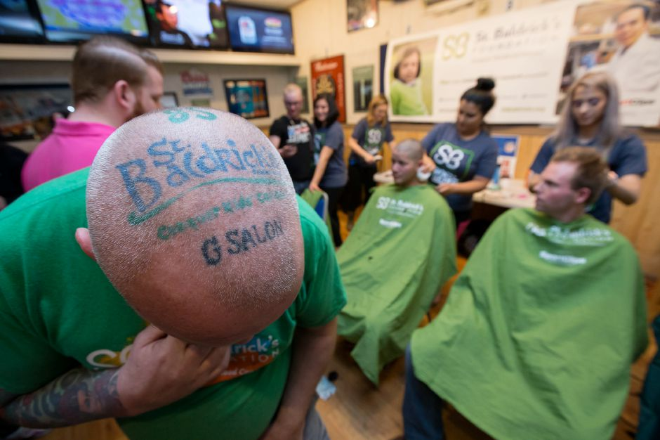 Doug Roper of Southington shows off his tattoo Saturday during the annual St. Baldrick