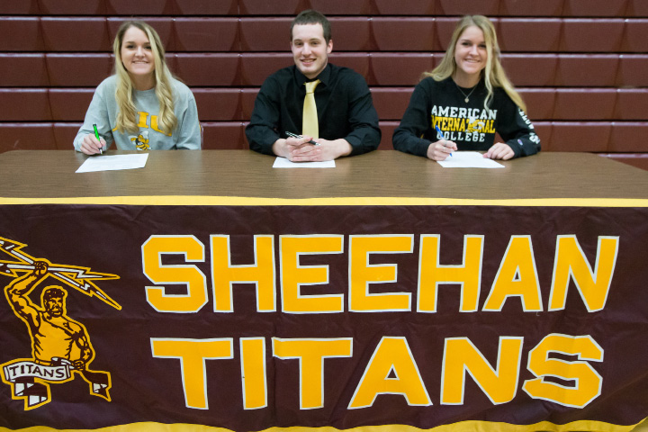 Sheehan seniors, left to right, Emilee Giacondino, Danny James and Natalee Giacondino sign their National Letters of Intent Thursday at Sheehan High School. The three are heading to AIC in Springfield, Mass. James will be playing football. The Giacondino twins will be playing lacrosse. | Justin Weekes / For the Record-Journal