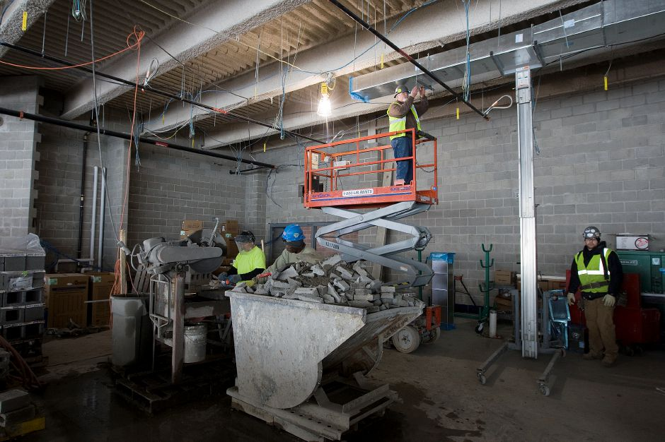 Construction crews work in the future cafeteria of Platt High School, Tuesday, February 17, 2015. Both Platt and Maloney high schools are in the second of four-phase renovation and construction projects. | Dave Zajac / Record-Journal