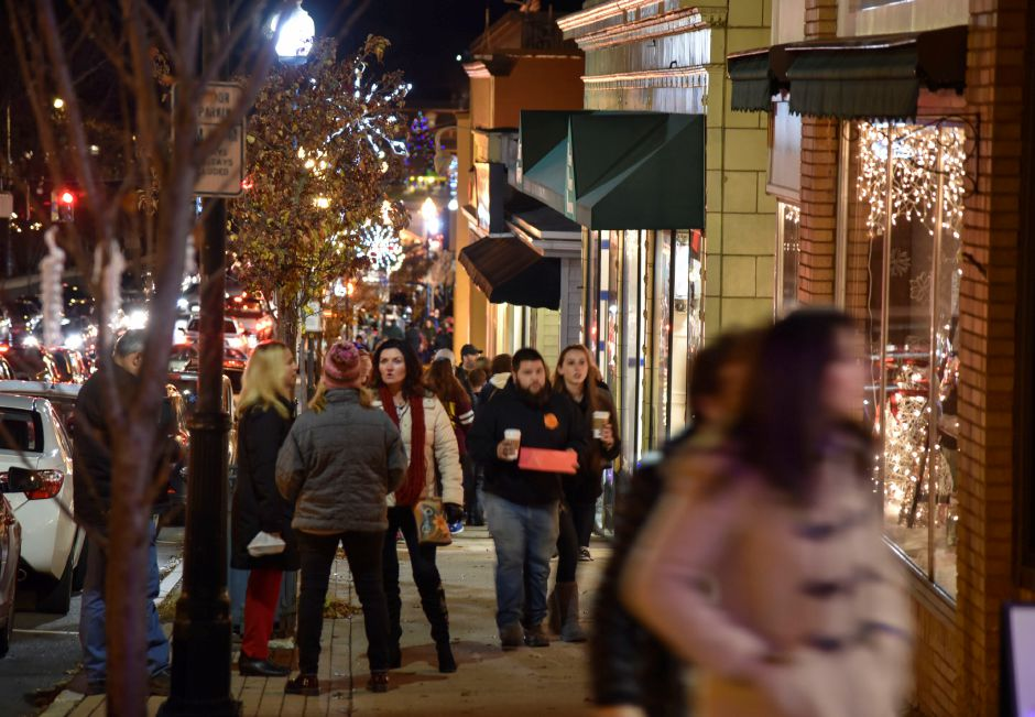 Strollers enjoy free refreshments and discounts at local stores during the 9th annual Holiday Stroll in downtown Wallingford on Friday, Dec. 1, 2017. | Bailey Wright, Record-Journal