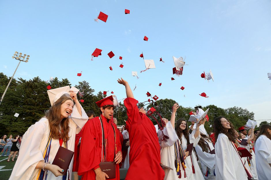 Cheshire graduates toss their hats in the air celebrating officially graduating from Cheshire High School on Friday June 21, 2013. (Matt Andrew/ For the Record Journal)