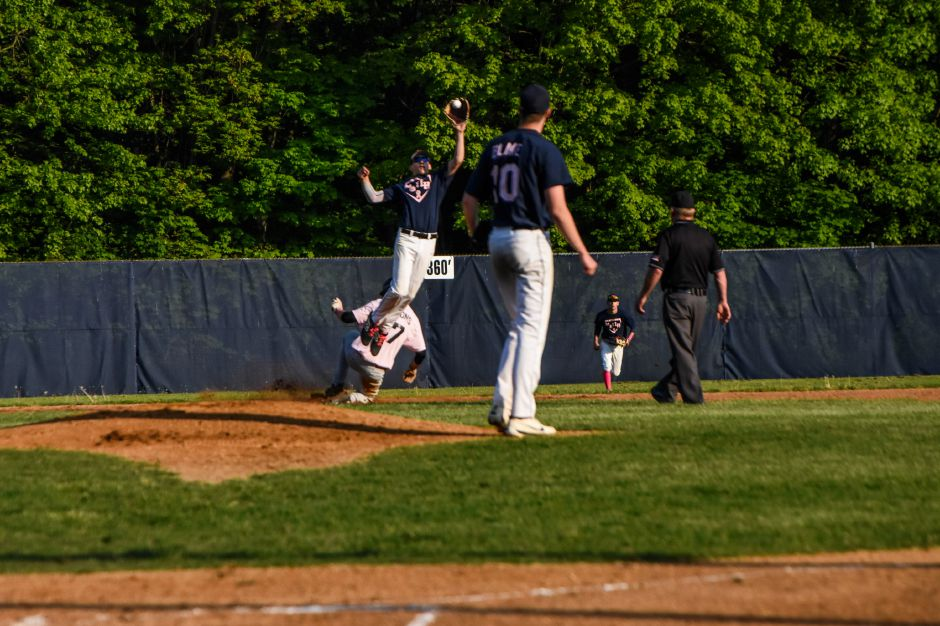 Sheehan's Kyle Simmons slides in safely at second base as Lyman Hall's Justin Hackett fields a high throw Friday night at Pat Wall Field. | | Jim McGovern, Special to the Record-Journal