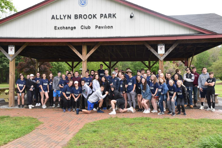 Coginchaug Regional High School seniors pose at Allyn Brook Park where they had breakfast before heading off  to separate locations for Senior Service Day. | Bailey Wright, Town Times