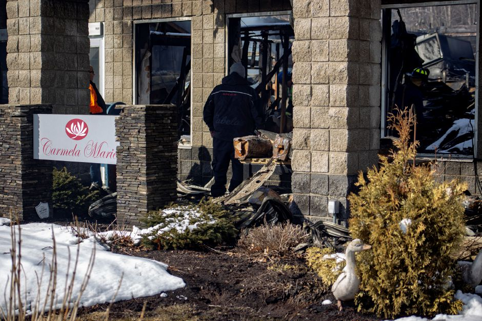 Crews sift through the wreckage in the aftermath of a fire a Tops Market in Southington March 4, 2019. | Richie Rathsack, Record-Journal