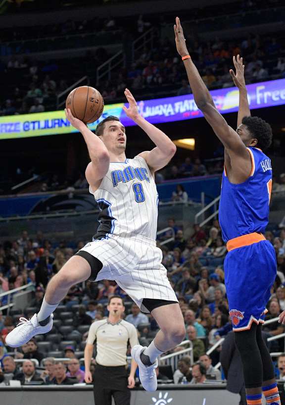 Orlando Magic guard Mario Hezonja (8) goes up for a shot in front of New York Knicks guard Justin Holiday, right, during the first half of an NBA basketball game in Orlando, Fla., Monday, March 6, 2017. (AP Photo/Phelan M. Ebenhack)