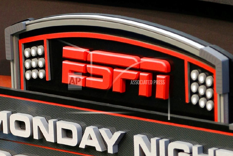 FILE - This Sept. 16, 2013, file photo shows the ESPN logo prior to an NFL football game between the Cincinnati Bengals and the Pittsburgh Steelers, in Cincinnati. ESPN says it is eliminating 150 studio and production employees as the sports broadcasting giant continues to shift its focus to a more digital future. The company says the layoffs, which were announced Wednesday morning, Nov. 29, 2017, in a memo to employees, don