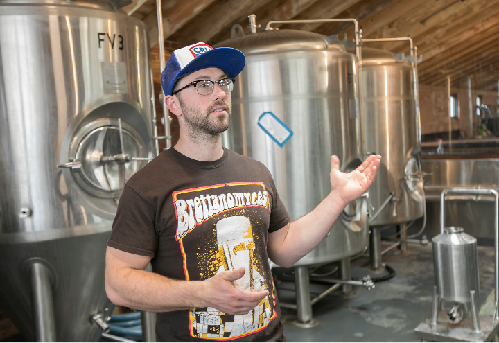 Bob Bartholomew, head brewer of Kinsmen Brewing Co., talks Wednesday about the new family-owned and operated brewery at 409 Canal St. in Southington. | Dave Zajac, Record-Journal