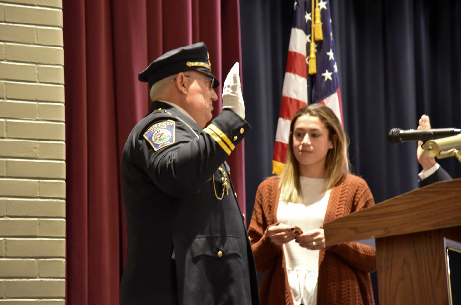Board of police comissioners chairman David Monz swears in Lt. Stanley Lofquist as a new captain, during a special meeting at the middle school on Jan. 15, 2019. His daughter, Rebecca Fasulo pinned him. | Bailey Wright, Record-Journal