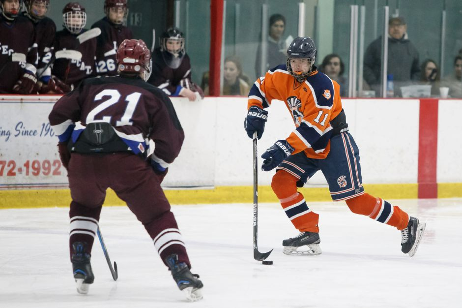 Matt Pettit gains the offensive zone Wednesday for the Trojans at the Northford Ice Pavilion against BBD. Pettit had a goal in the Lyman Hall Co-op's 8-1 victory.