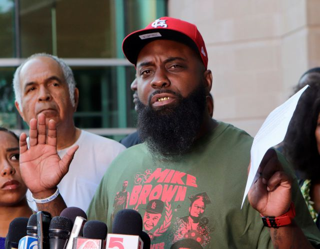 Michael Brown Sr. speaks to the media on Friday, Aug. 9, 2019, the fifth anniversary of the death of his son, Michael Brown, in front of the justice center in Clayton, Mo. Brown asked St. Louis County Prosecutor Wesley Bell to re-examine the evidence in his son