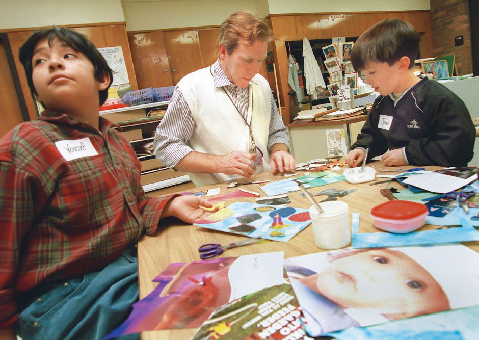 RJ file photo - Artist Will Johnson, center, of Paper Magic, helps Nathan Hale School fourth-graders Joshua Turner, 10, right, and Yousef Silva, 9, with their greeting card creations during a visit Dec. 13, 1998.