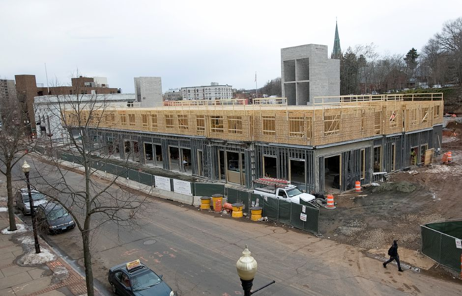 Crews continue construction on a mixed-used building and parking garage at 24 Colony St. in Meriden, Monday, February 1, 2016. | Dave Zajac / Record-Journal