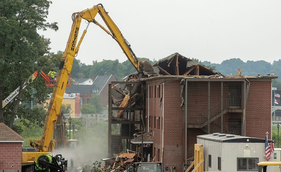 Demolition crews take down a building in the former Mills Memorial Apartments complex in downtown Meriden, Friday, August 17, 2018. Dave Zajac, Record-Journal