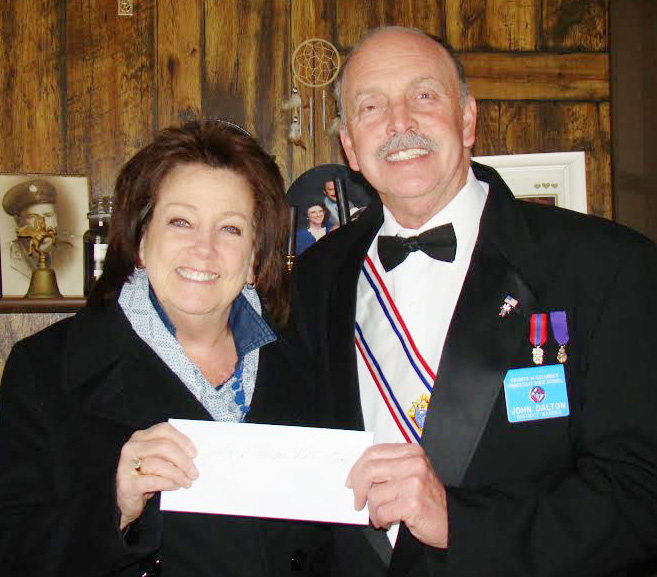 J.J. Nerden Camp's Laurie Russel receiving check from Sir John.