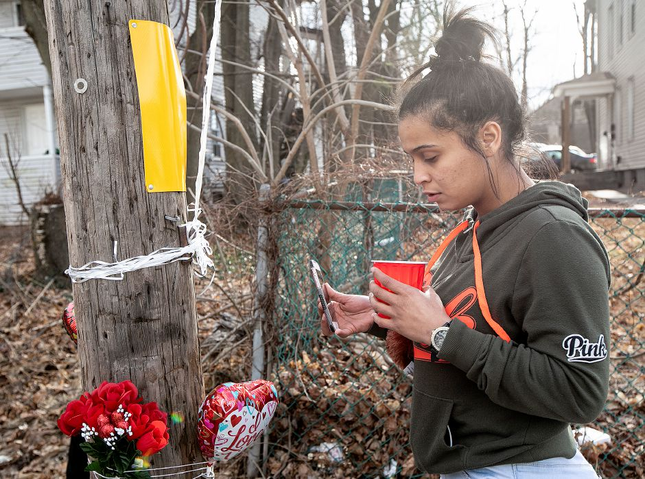 Brianna Torres, of Meriden, reflects at a memorial for friend Aaron Joseph Ormsby, 21, on Foster Street in Meriden, Fri., Jan. 18, 2019. Ormsby was shot and killed in the back of a residence at 130 Foster Street Thursday night. Dave Zajac, Record-Journal