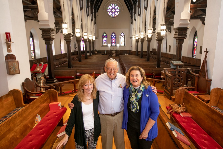 The Rev. Dee Anne Dodd, right, stands Wednesday with longtime parishoners Robin Hunter and Daniel Lyon in the sanctuary of St. Paul