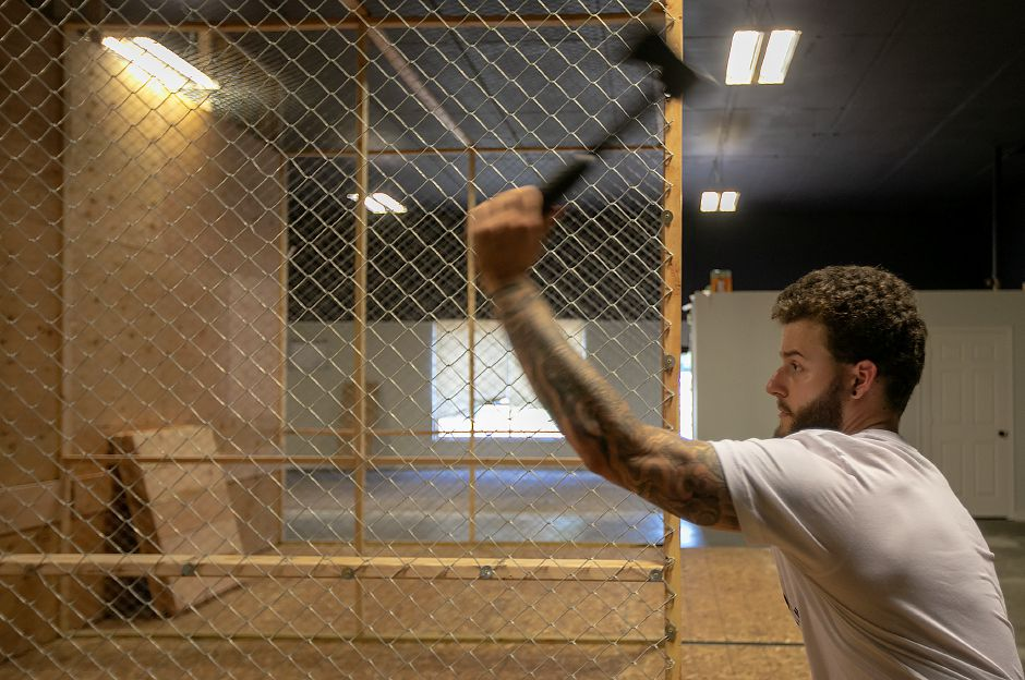 Jerry Ferraro, of Wallingford, co-owner of Blue Ox Axe Throwing, takes aim with an axe at the new business at 21 N. Plains Industrial Rd. in Wallingford, Friday, July 20, 2018. The business opens in August. Dave Zajac, Record-Journal