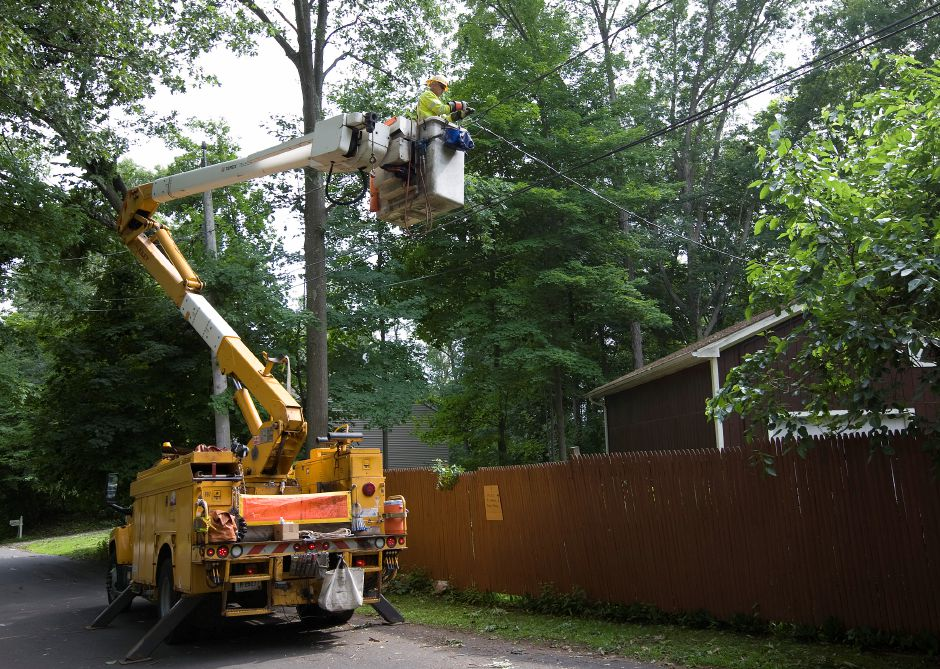 A United Illuminating employee works to restore power to a residence on Eaton Trail in Wallingford, Thursday, June 25, 2015. | Dave Zajac / Record-Journal