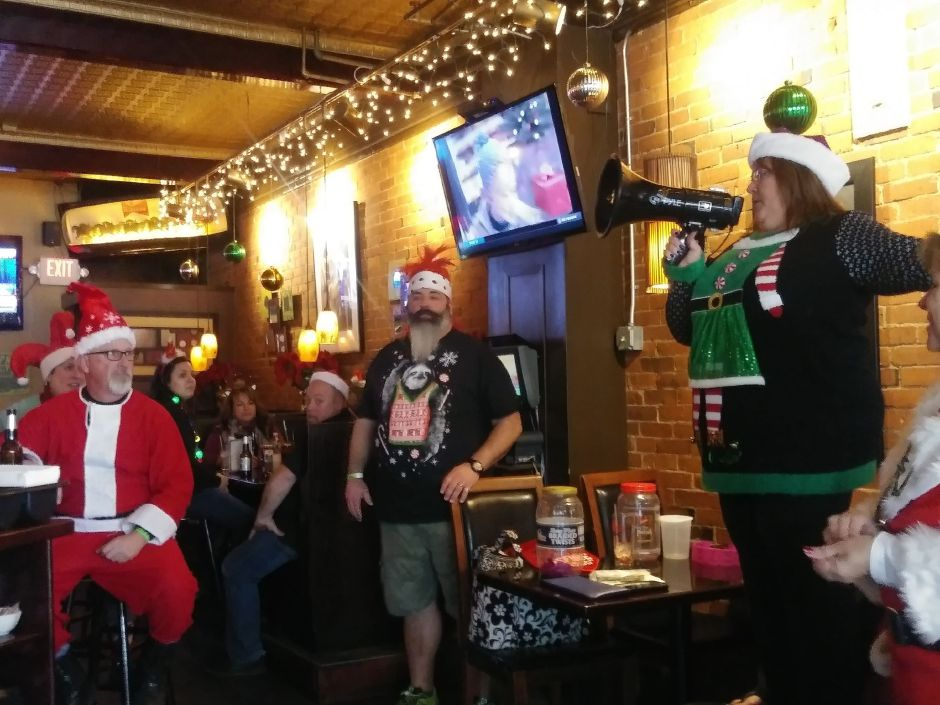 Michele Stocking announces winner at Gaetano's during SantaCon in Wallingford. Saturday, December 8, 2018. Jeniece Roman. Record-Journal