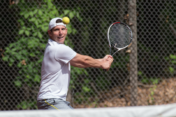 Aaron Kusza in the mixed A doubles final Sunday during the Wink Filipek Sr. Memorial Tennis tournament at Copper Valley Swim and Tennis Club in Cheshire Jun. 11, 2017 | Justin Weekes / For the Record-Journal