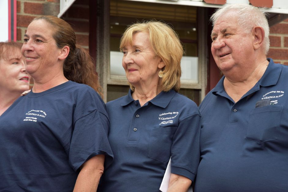 Owners of Z. Czapiga & Son in Meriden from left, Patti Shara, and Diane and Joe Paluszewski, join community members in celebrating the store
