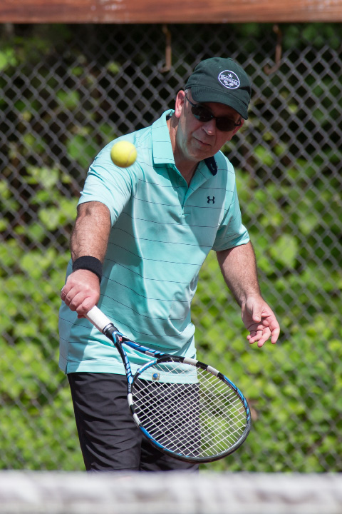 Rob Simon in the mixed B doubles final Sunday during the Wink Filipek Sr. Memorial Tennis tournament at Copper Valley Swim and Tennis Club in Cheshire Jun. 11, 2017 | Justin Weekes / For the Record-Journal