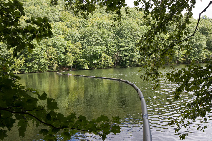 A floating partition was installed at Bradley-Hubbard Reservoir to help solve an algae problem that has caused a foul odor and taste in Meriden's drinking water.   | Dave Zajac, Record-Journal