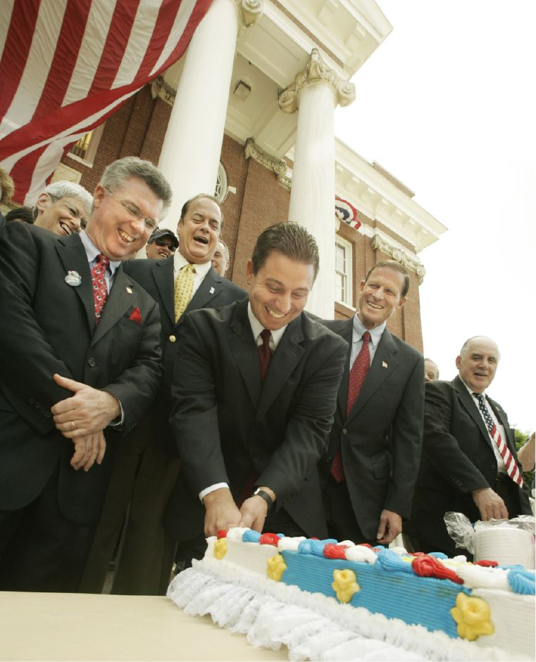Mayor Mark Benigni, center, cuts the Bicentennial cake in front of City Hall Fri., June 16, 2006 as state Rep Christopher Donovan, left, and state Sen. Thomas Gaffey, 2nd from left laugh with State Atty Gen. Richard Blumenthal, 2nd from right, and Dep. Mayor Matthew Dominello, right.