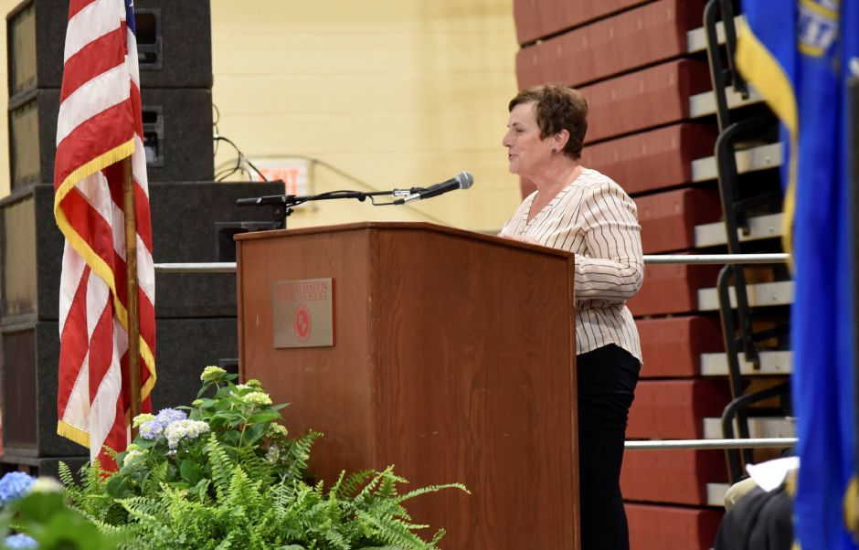 Board of Education chairwoman Anita Anderson congratulates seniors during the North Haven High School graduation ceremonies indoors at the school on June 13, 2019. | Bailey Wright, Record-Journal