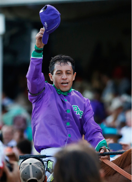 Victor Espinoza celebrates after riding California Chrome to victory during the 140th running of the Kentucky Derby horse race at Churchill Downs Saturday, May 3, 2014, in Louisville, Ky.  (AP Photo/Matt Slocum)