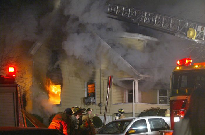 Meriden firefighters on the scene of a blaze that consumed a house at 105 South Vine Street in Meriden late Monday evening December 19, 2005. (dave zajac photo)
