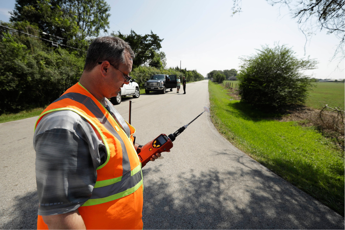 Mike Cossey, of Bureau Veritas, uses an air monitor to check the quality of air at a police roadblock marking the 1.5-mile perimeter of the evacuation area around the Arkema Inc. chemical plant Thursday, Aug. 31, 2017, in Crosby, Texas. The Houston-area chemical plant that lost power after Harvey engulfed the area in extensive floods was rocked by multiple explosions early Thursday, the plant