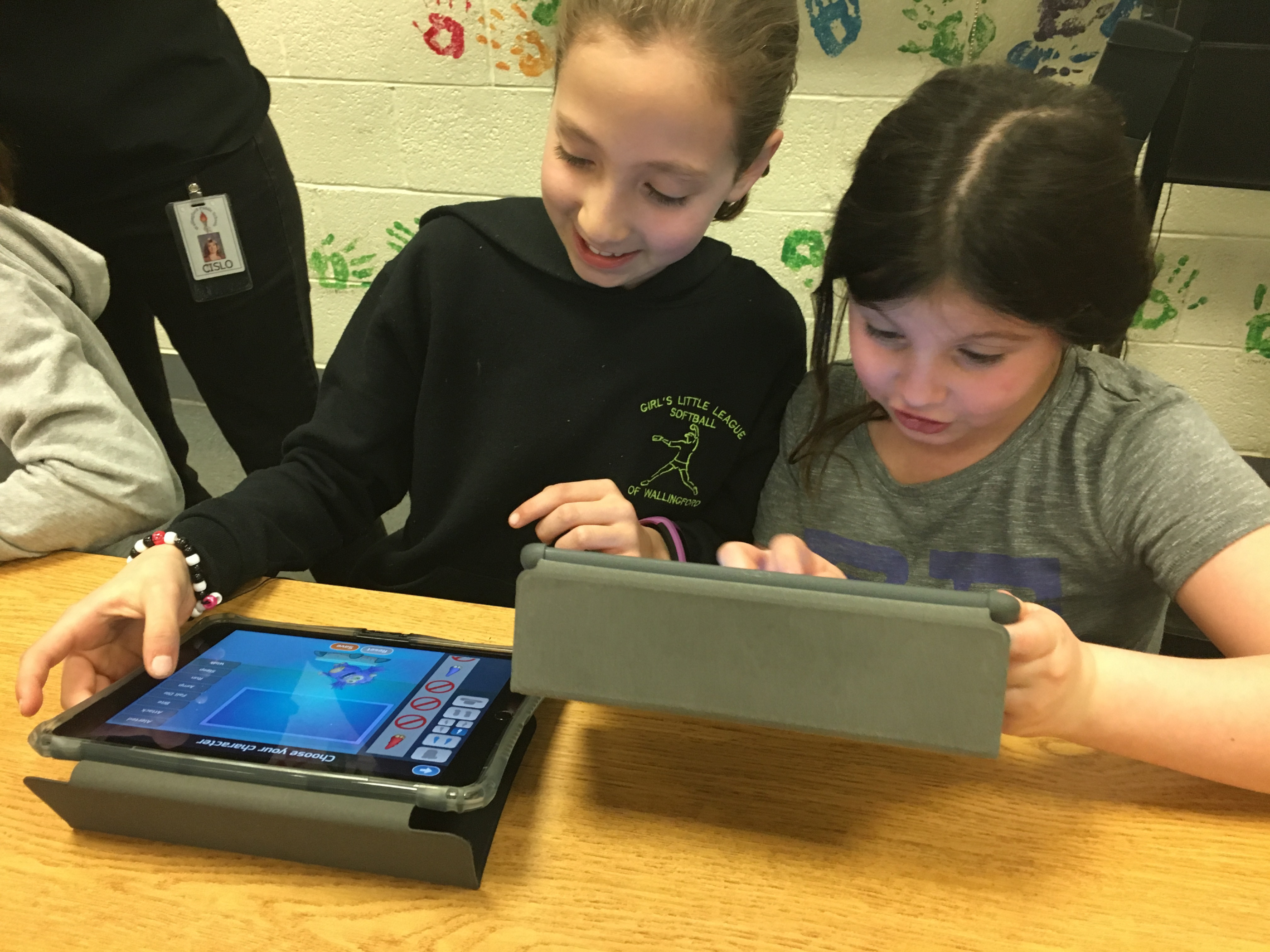 Pond Hill Elementary School third-graders Isabella Galushko, left, and Katherine Clark play Candy Quest, a computer programming game, at a girls coding night in Wallingford on Thursday, March 30, 2017. | Lauren Takores, Record-Journal