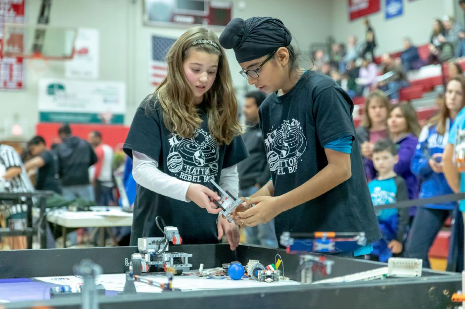 Members of the FIRST Lego League Hatton Rebel Bots, from Southington, perform mid-game adjustments to their robot during a tournament held at Berlin High School on Nov. 17. | Devin Leith-Yessian, The Citizen
