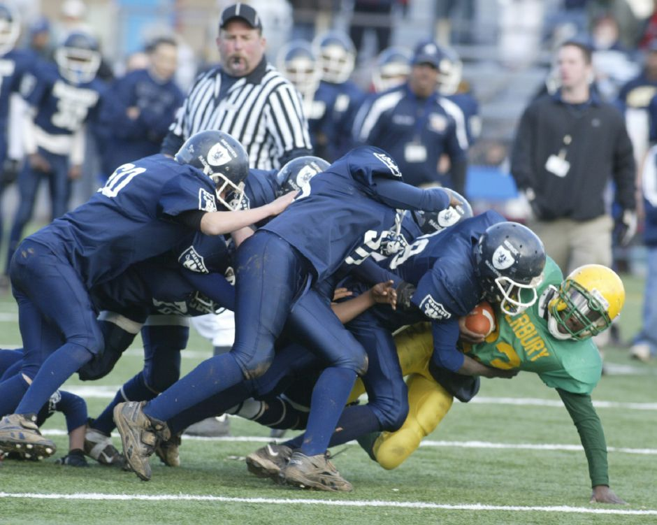 A host of Meriden Raiders tackles Waterbury