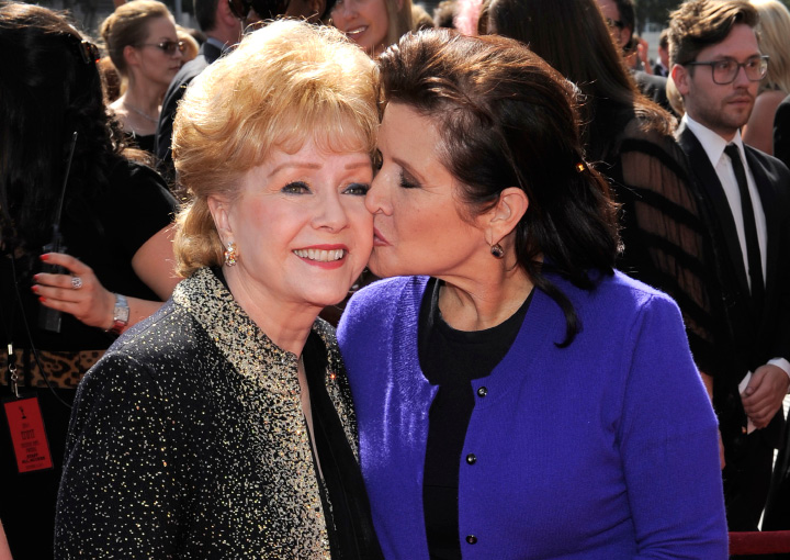 "FILE- In this Sept. 10, 2011, file photo, Debbie Reynolds, left, and Carrie Fisher arrive at the Primetime Creative Arts Emmy Awards in Los Angeles. Reynolds, star of the 1952 classic ""Singin"