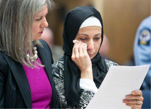 Mervat Ghazal, daughter of Ibrahim Ghazal, wipes a tear away as she reads a statement on behalf of the family at the sentencing of Frankie Resto in Superior Court in New Haven, Feb. 28, 2014. Resto plead guilty to the murder of Ibrahim Ghazal in November of 2013. | Christopher Zajac / Record-Journal
