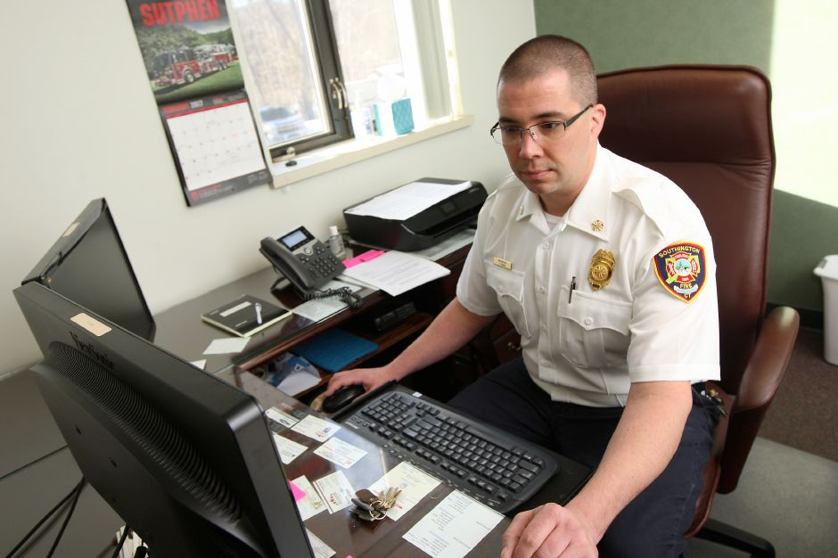 Eric Heath, interim fire chief at his desk at the Southington Fire Department Headquarters on North Main Street , Friday, February 17, 2017. | Dave Zajac, Record-Journal