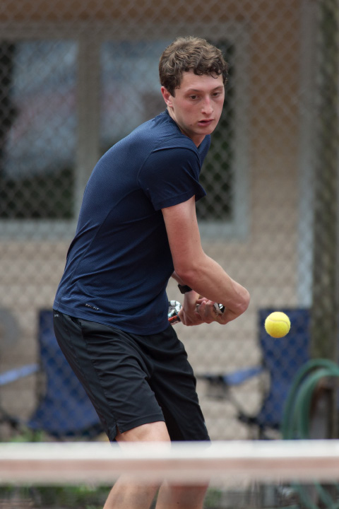 Phillip Schmitt in the high school boys singles final Sunday during the Wink Filipek Sr. Memorial Tennis tournament at Copper Valley Swim and Tennis Club in Cheshire Jun. 11, 2017 | Justin Weekes / For the Record-Journal