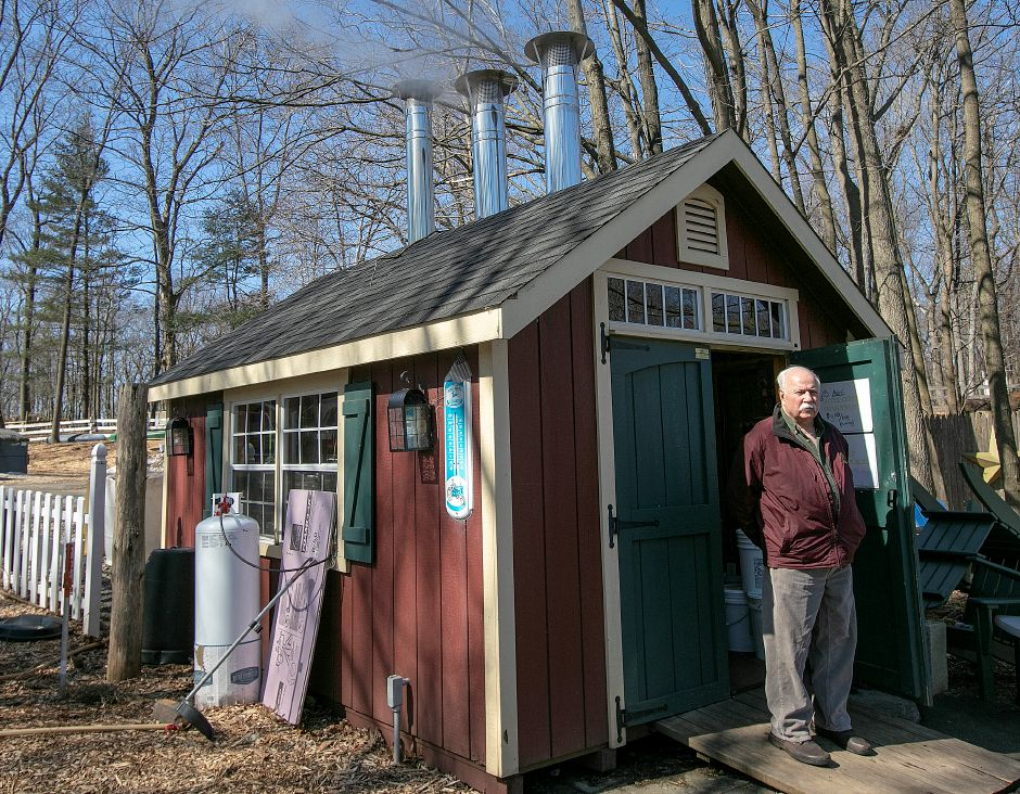 Michael Karabin of Karabin Farms takes a break outside his sugarhouse while making maple syrup at the Southington farm located at 894 Andrews St., Tues., Mar. 19, 2019. Dave Zajac, Record-Journal