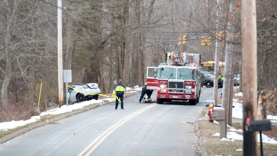 Emergency crews responded to a car which struck a treet on Highland Road in Wallingford. Police said one person was injured in the collision. | Devin Leith-Yessian / Record-Journal