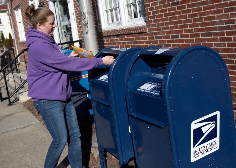 Tory Whittington, of Cheshire, mails a package at the Cheshire Post Office, Fri. Feb. 8, 2019. New mailboxes have been installed at the Cheshire Post Office to replace ones damaged by thieves recently. Dave Zajac, Record-Journal