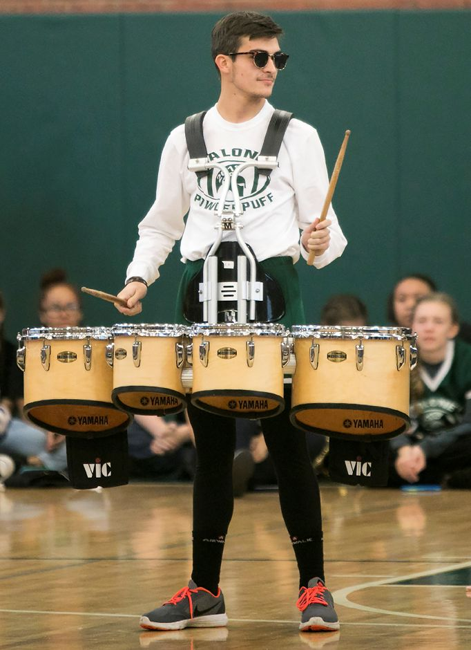 Evan Adamowicz, 18, performs with the Maloney drumline during the annual pep rally at Maloney High School in Meriden, Wednesday, Nov. 22, 2017. | Dave Zajac, Record-Journal
