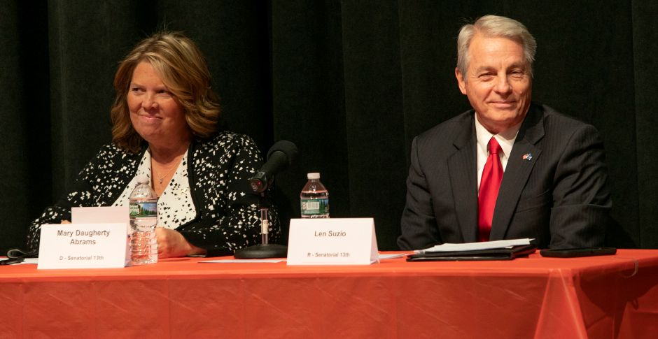 Democratic nominee Mary Dougherty Abrams and Sen. Len Suzio, R-Meriden prepare to debate at Washington Middle School sponsored by the Record-Journal, Midstate Chamber of Commerce, and Meriden Board of Education, Thursday, Oct. 18, 2018. Republican, Democratic and Libertarian candidates in three local races were sharply divided Thursday on the implementation of tolls, how to close a $4.5 billion deficit, and other issues. Dave Zajac, Record-Journal