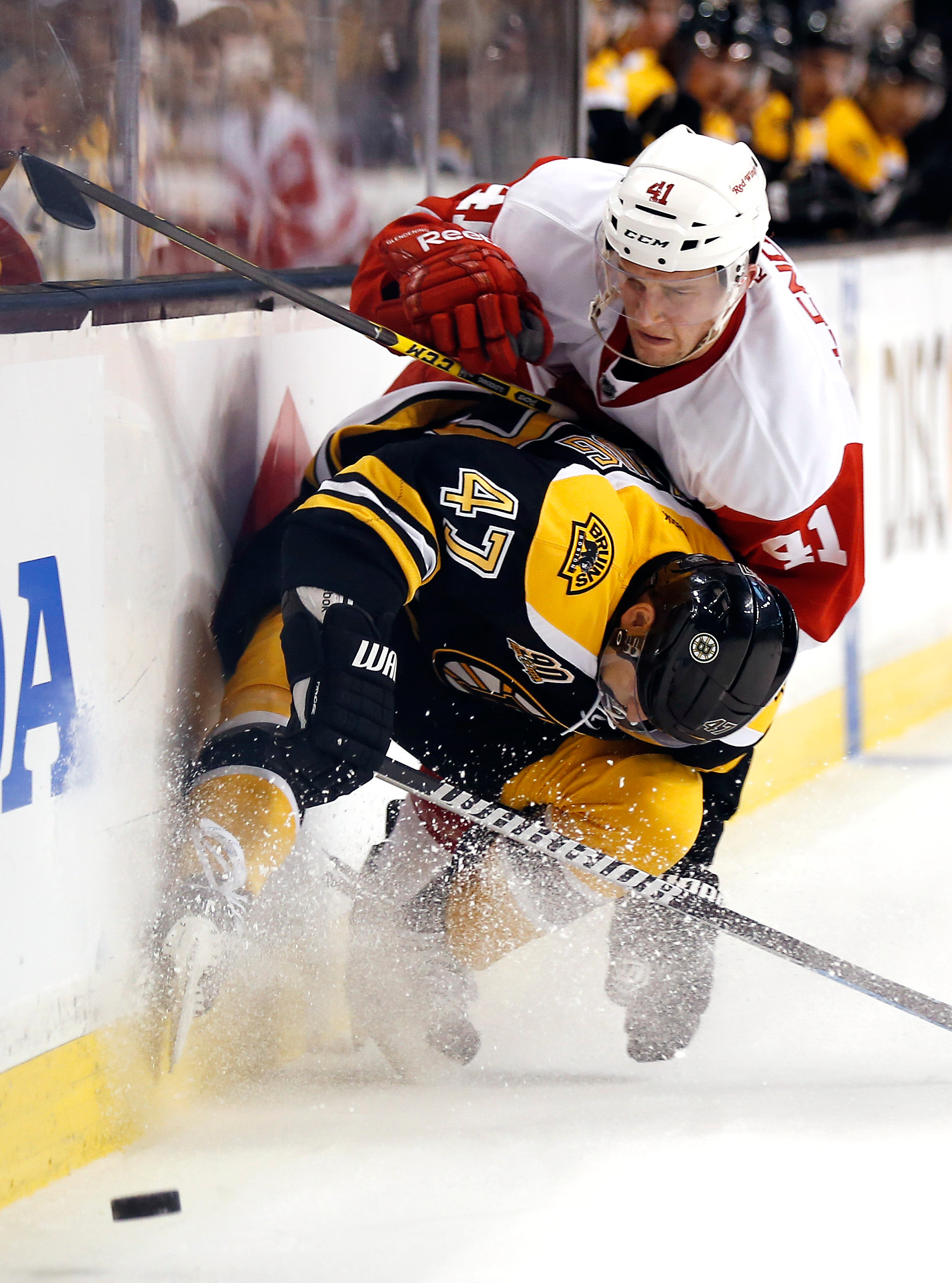 Bruins' defenseman Torey Krug (47) stops Detroit's Luke Glendening from getting around him during Sunday's NHL playoff game in Boston. | Associated Press