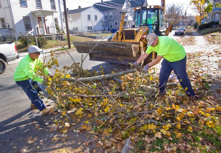 A Meriden DPW road crew clears branches, remnants of last week