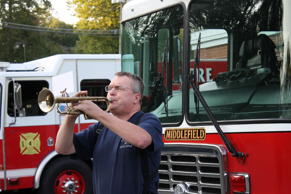 Ken Hamilton of Middlefield plays trumpet during last year's 9/11 ceremony. | File photo