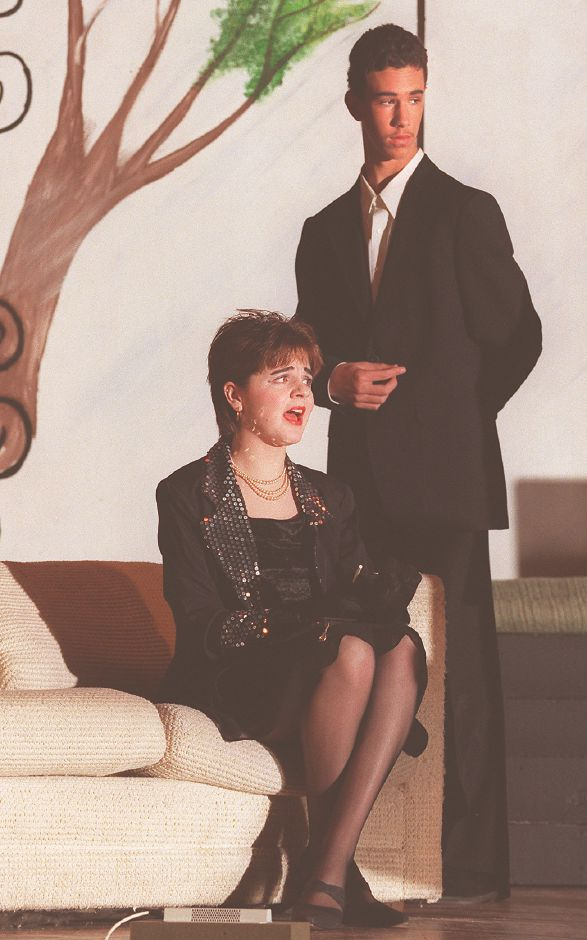 "RJ file photo - Maloney High School students Sara Frawley and Kris Peterson rehearse their parts as ""Lily Belle"" and ""Titus Savage"" in ""The Curious Savage."" The play was performed by Maloney High School students, Dec. 1998."