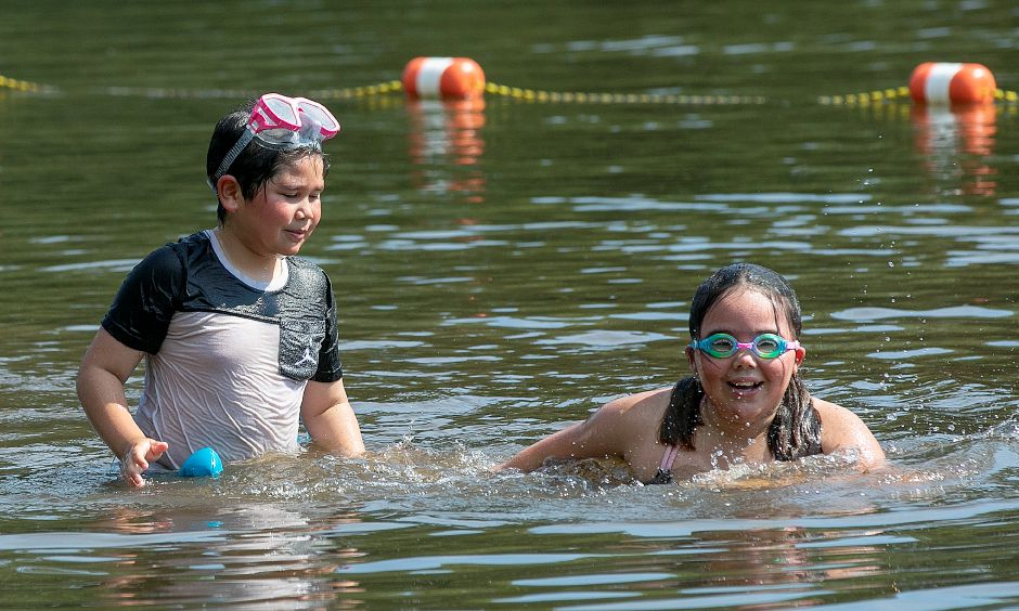 Kristian Santiago, 7, and his 10-year-old sister Leilani,  of Wallingford, enjoy swimming at Wharton Brook State Park in Wallingford on Wednesday. See more photos inside on Page C3 and online at myrecordjournal.com